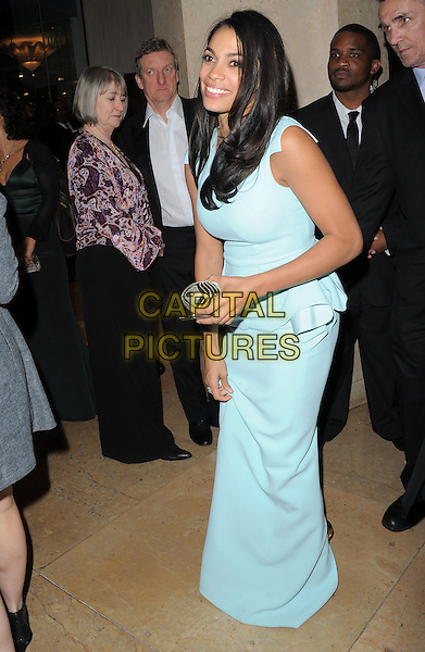 Rosario Dawson.Exiting The 70th Annual Golden Globe Awards held at The Beverly Hilton Hotel in Beverly Hills, California, USA..January 13th, 2013.globes full length blue sleeveless peplum dress bending leaning side   .CAP/DVS.©DVS/Capital Pictures.