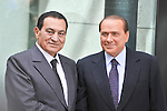 Egyptian President Hosni Mubarak (L) and Italian Prime Minister Silvio Berlusconi attend an inauguration ceremony for the renovated Egyptian Academy in Rome on Sept. 23, 2010.