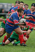 R. Avei makes one of his telling runs as the Waiuku defense try to tackle him from behind. Counties Manukau Premier Club Rugby, Ardmore Marist vs Waiuku played at Bruce Pulman Park, Papakura on the 29th of April 2006. Ardmore Marist won 10 - 9.