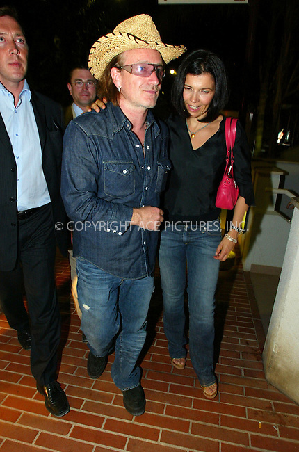 Bono (U2) and wife Alison Stewart at the Karement Summer Party, Karement Club, Monte Carlo, Monaco - 21/08/04..FAMOUS PICTURES AND FEATURES AGENCY.tel  +44 (0) 20 7731 9333.fax +44 (0) 20 7731 9330.e-mail info@famous.uk.com.www.famous.uk.com.FAM13406