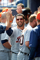 Detroit Tigers shortstop Mike Aviles (14) high fives teammates during a Spring Training game against the New York Yankees on March 2, 2016 at George M. Steinbrenner Field in Tampa, Florida.  New York defeated Detroit 10-9.  (Mike Janes/Four Seam Images)