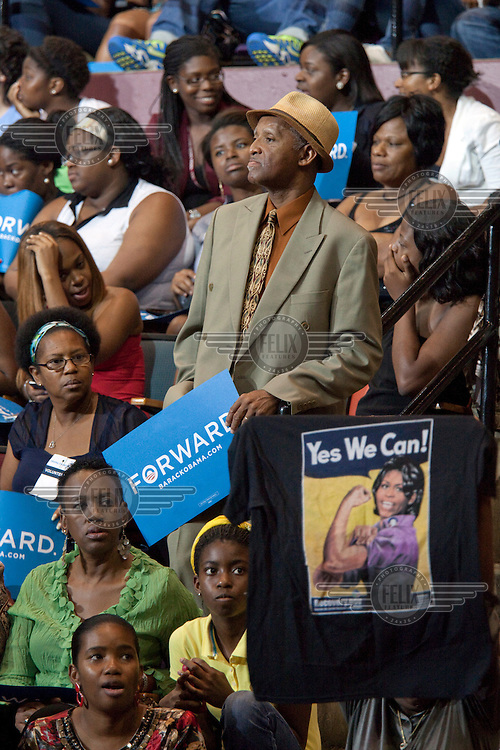 Supporters of President Obama watch a video message from the President while wait for Michele Obama to appear at a rally in Tallahassee, Florida. The US Presidential election will be held on 6 November, 2012...