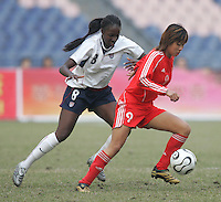 January 30, 2007: Tina Frimpong tries to catch Han Duan. The U.S. defeated China, 2-0, to win the Four Nations Tournament at Guangdong Olympic Stadium in Guangzhou, China.  Han Duan,