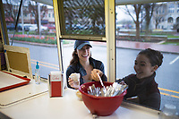 NWA Democrat-Gazette/CHARLIE KAIJO Elizabeth Dennen of Rogers (from left) and Lindsey Strok of Rogers get ice cream, Thursday, March 29, 2018 at The Walmart Museum at Bentonville Square in Bentonville. <br />