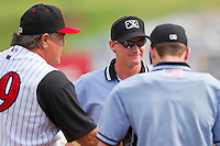 Base umpire Ryan Clark listens to the Ground Rules prior to the start of the South Atlantic League game between the West Virginia Power and the Kannapolis Intimidators at Fieldcrest Cannon Stadium on April 20, 2011 in Kannapolis, North Carolina.   Photo by Brian Westerholt / Four Seam Images