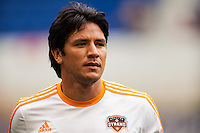 Brian Ching (25) of the Houston Dynamo. The New York Red Bulls defeated the Houston Dynamo 2-0 during a Major League Soccer (MLS) match at Red Bull Arena in Harrison, NJ, on June 30, 2013.
