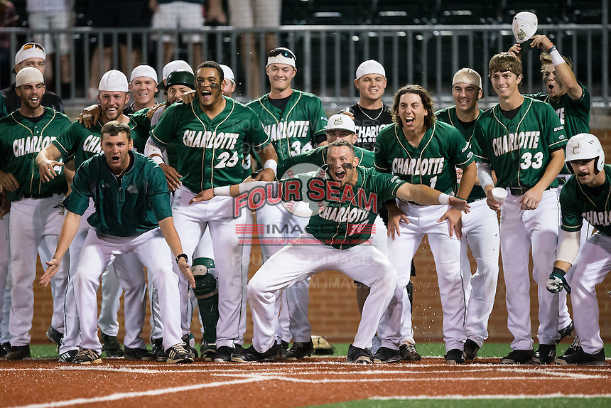The Charlotte 49ers wait at home plate for the arrival of teammate Brett Netzer (not pictured) after he hit a walk-off home run in the bottom of the 9th inning against the Wake Forest Demon Deacons at Hayes Stadium on March 16, 2016 in Charlotte, North Carolina.  The 49ers defeated the Demon Deacons 7-6.  (Brian Westerholt/Four Seam Images)