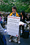 "Protester holds ""Johnson & Johnson"" sign at the Occupy Wall Street Protest in New York City October 6, 2011."