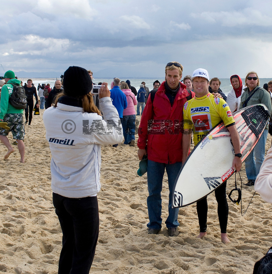 Taj Burrows getting photographed with fans at the Quiksilver Pro in Hossegor, France.
