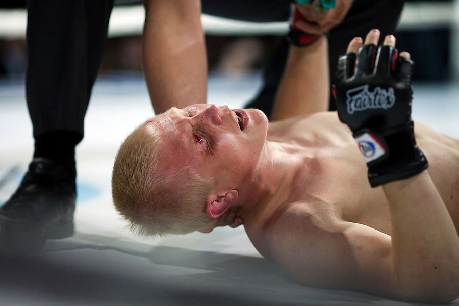 Moscow, Russia, 05/06/2010..Danil Turinge falls to the canvas with an injured eye after being punched in the face by Zubaira Tukhugov  during a mix-fight bout at Fight Nights, a new Moscow boxing tournament..