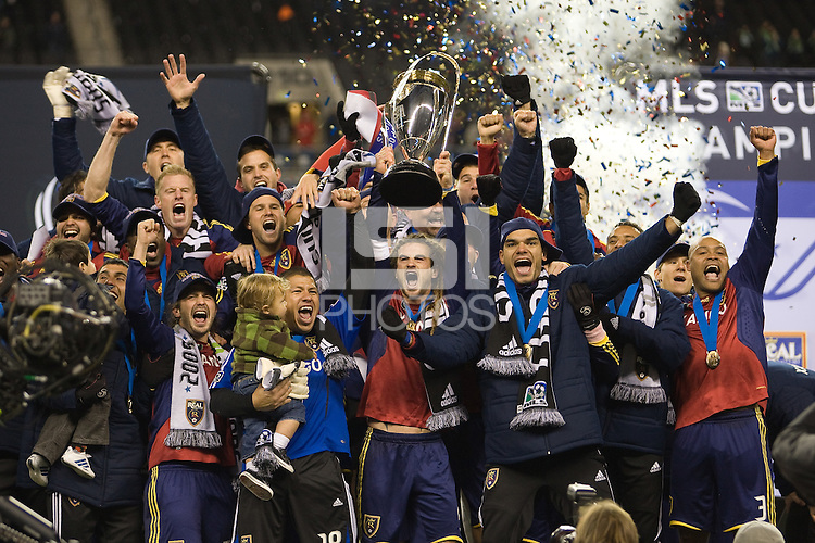 Kyle Beckerman holds the MLS Cup trophy and celebrates with his team after Real Salt Lake defeats the Los Angles Galaxy 5-4 on penalty kicks to win the 2009 MLS Cup at Qwest Field, Sunday, Nov. 22, 2009.