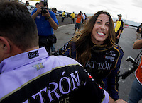 Feb 23, 2014; Chandler, AZ, USA; NHRA funny car driver Alexis DeJoria celebrates with her crew after winning the Carquest Auto Parts Nationals at Wild Horse Motorsports Park. Mandatory Credit: Mark J. Rebilas-USA TODAY Sports