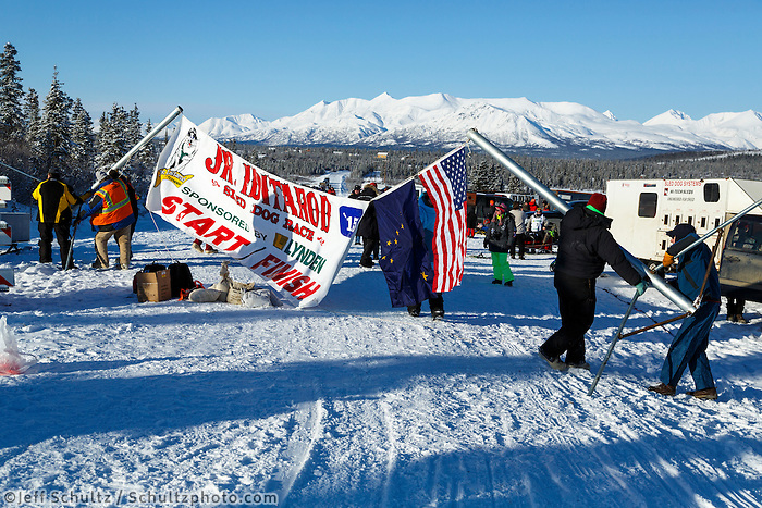 Volunteers erect the start and finish banner for the 2015 Junior Iditarod start along the Denali Highway on Sunday March 1, 2015.<br /> <br /> <br /> <br /> (C) Jeff Schultz/SchultzPhoto.com - ALL RIGHTS RESERVED<br />  DUPLICATION  PROHIBITED  WITHOUT  PERMISSION