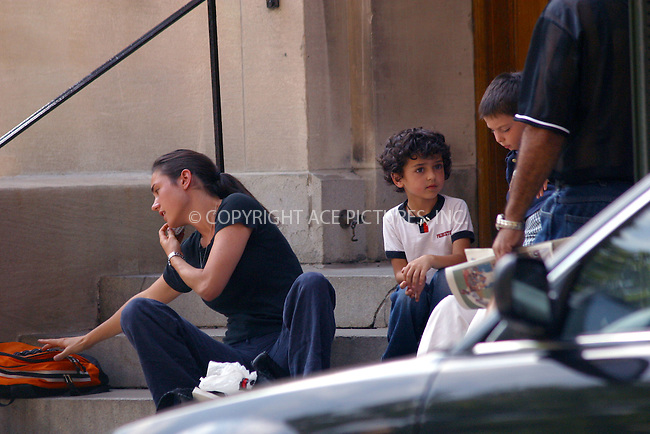 Despite her raising Hollywood career, Jennifer Connelly (A Beautiful Mind, Requiem For a Dream) sets her priorities straight as she drops off and picks up her son Kai as school on Central Park West every day. Jennifer resides in West Village, which is about 70 street blocks away from her son's school. September 10, 2002. Please byline: Alecsey Boldeskul/NY Photo Press.   ..*PAY-PER-USE*      ....NY Photo Press:  ..phone (646) 267-6913;   ..e-mail: info@nyphotopress.com