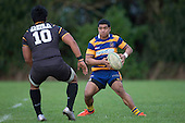 Violeti Taulani looks for options as he is confronted by Ki Anufe. Counties Manukau Premier Club Rugby game between Patumahoe & Bombay, played at Patumahoe on Saturday June 18th 2016. Patumahoe won the game 27 - 15 after leading 9 - 3 at halftime. Photo by Richard Spranger.