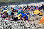 Tents windbreaks Whitesands beach St Davids Pembrokeshire Wales