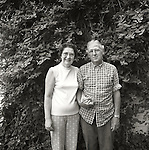 Portrait of couple in front of honeysuckle vine. 1976