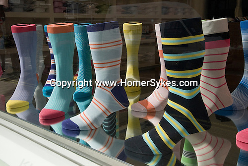 Mens fashion socks in department store window. Central London off Saville Row. England. 2006