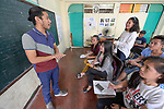 "Larren Jo ""LJ"" Bacilio, a teacher in the Alternative Learning System of the Kapatiran-Kaunlaran Foundation (KKFI), talks with students in a class in the Tondo neighborhood of Manila, Philippines. <br /> <br /> KKFI is supported by United Methodist Women."