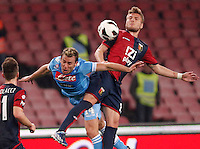 Naples's    Hugo Campagnaro   Emanuel fight for the ball   during Italian Serie A soccer match against Genoa at the San Paolo  stadium in Naples April 7, 2013