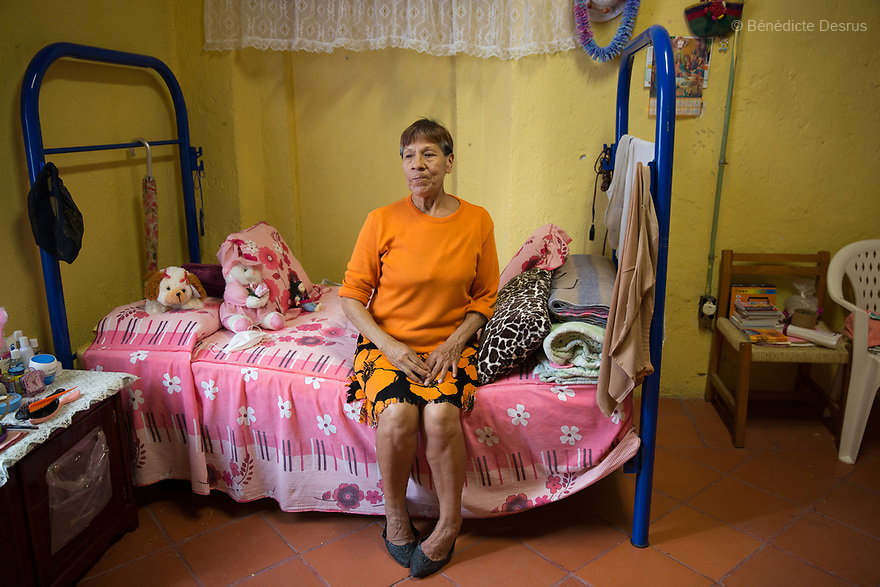 Rosa Belén, a resident of Casa Xochiquetzal, portrayed in her bedroom at the shelter in Mexico City, Mexico on February 10, 2017. Casa Xochiquetzal is a shelter for elderly sex workers in Mexico City. It gives the women refuge, food, health services, a space to learn about their human rights and courses to help them rediscover their self-confidence and deal with traumatic aspects of their lives. Casa Xochiquetzal provides a space to age with dignity for a group of vulnerable women who are often invisible to society at large. It is the only such shelter existing in Latin America. Photo by Bénédicte Desrus