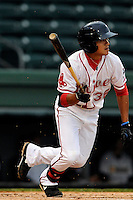 Tzu-Wei Lin (36) of the Greenville Drive bats in a game against the Charleston RiverDogs on Monday, April 14, 2014, at Fluor Field at the West End in Greenville, South Carolina. Lin is the No. 28 prospect of the Boston Red Sox, according to Baseball America. (Tom Priddy/Four Seam Images)