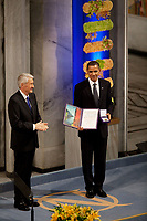 Nobel Committee Chairman Thorbjorn Jagland presents President Barack Obama with the Nobel Prize medal and diploma during the Nobel Peace Prize ceremony in Raadhuset Main Hall at Oslo City Hall in Oslo, Norway, Dec. 10, 2009. (Official White House Photo by Pete Souza)<br /> <br /> This official White House photograph is being made available only for publication by news organizations and/or for personal use printing by the subject(s) of the photograph. The photograph may not be manipulated in any way and may not be used in commercial or political materials, advertisements, emails, products, promotions that in any way suggests approval or endorsement of the President, the First Family, or the White House.