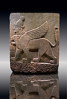 Picture & image of a Neo-Hittite orthostat describing the legend of Gilgamesh from Karkamis,, Turkey.  A three headed Sphinx which is a winged lion with a human heas and a bird of prey's head on the end of its tail . An Ankara Museum of Anatolian Civilizations exhibit.