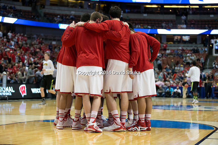 Wisconsin Badgers huddle prior to their fourth-round game in the NCAA college basketball tournament against the Baylor Bears Thursday, March 27, 2014 in Anaheim, California. The Badgers won 69-52. (Photo by David Stluka)