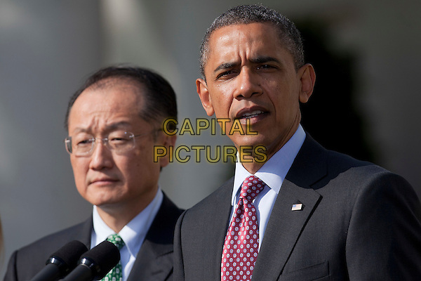 United States President Barack Obama, right, introduces Jim Yong Kim, president of Dartmouth College, as a nominee to become president of the World Bank in the Rose Garden of the White House in Washington, D.C., U.S., on Friday, March 23, 2012. Kim was born in Seoul and is a U.S. citizen. He would succeed Robert Zoellick as the head of the bank. The bank made $57 billion loans in the last fiscal year.  .headshot portrait glasses .CAP/ADM/AH.©Andrew Harrer/Pool/CNP/AdMedia/Capital Pictures.