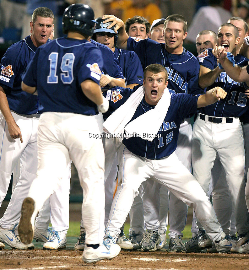North Carolina's Logan Munson (12) and the Tar Heels get set to mob Tim Federowicz (19) after his grand slam in the top of the ninth led North Carolina to a 7-3 victory over LSU in a 2008 College World Series elimination game. (Photo by Michelle Bishop) .