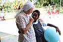 Sister Mary Margaret of  St. Leo the Great talks to students on the schoolyard, New Orleans, Monday, Aug. 24, 2015.