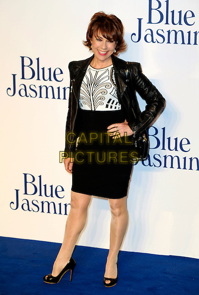 Kathy Lette <br /> UK Premiere of 'Blue Jasmine' at the Odeon West End, Leicester Square. London, England.<br /> 17th September 2013<br /> full length black jacket leather white dress skirt top hand on hip<br /> CAP/PP/GM<br /> &copy;Gary Mitchell/PP/Capital Pictures