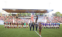 Portland, Oregon - Sunday April 17, 2016: The Portland Thorns FC and Orlando Pride line up for the playing of the national anthem. The Portland Thorns play the Orlando Pride during a regular season NWSL match at Providence Park.