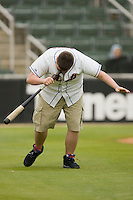 A fan competes in the dizzy bat race between innings at Fieldcrest Cannon Stadium April 14, 2010, in Kannapolis, North Carolina.  Photo by Brian Westerholt / Four Seam Images