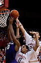 23 February 2011: Jorge Brian Diaz #21 of the Nebraska Cornhuskers gets the rebound away from Jacob Pullen #0 of the Kansas State Wildcats during the first half at the Devaney Sports Center in Lincoln, Nebraska. Kansas State defeated Nebraska 61 to 57.