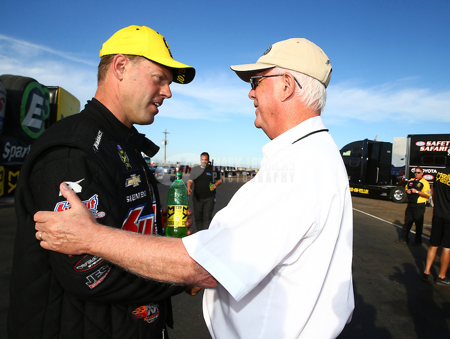 Feb 28, 2016; Chandler, AZ, USA; NHRA pro stock driver Jason Line (left) is congratulated by NHRA official Graham Light as he celebrates after winning the Carquest Nationals at Wild Horse Pass Motorsports Park. Mandatory Credit: Mark J. Rebilas-