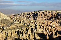 Eroded landscape of the Devrent Valley, known as Imagination Valley, near Goreme in Nevsehir province, Cappadocia, Central Anatolia, Turkey. The rock formations here were made by erosion of the volcanic tuff created by ash from volcanic eruptions millions of years ago, and many resemble figures or animals, such as camels, snakes, seals and dolphins. This area forms part of the Goreme National Park and the Rock Sites of Cappadocia UNESCO World Heritage Site. Picture by Manuel Cohen