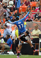 WASHINGTON, D.C. - AUGUST 19, 2012:  Andy Najar (14) of DC United upends Freddy Adu (11) of the Philadelphia Union during an MLS match at RFK Stadium, in Washington DC, on August 19. The game ended in a 1-1 tie.