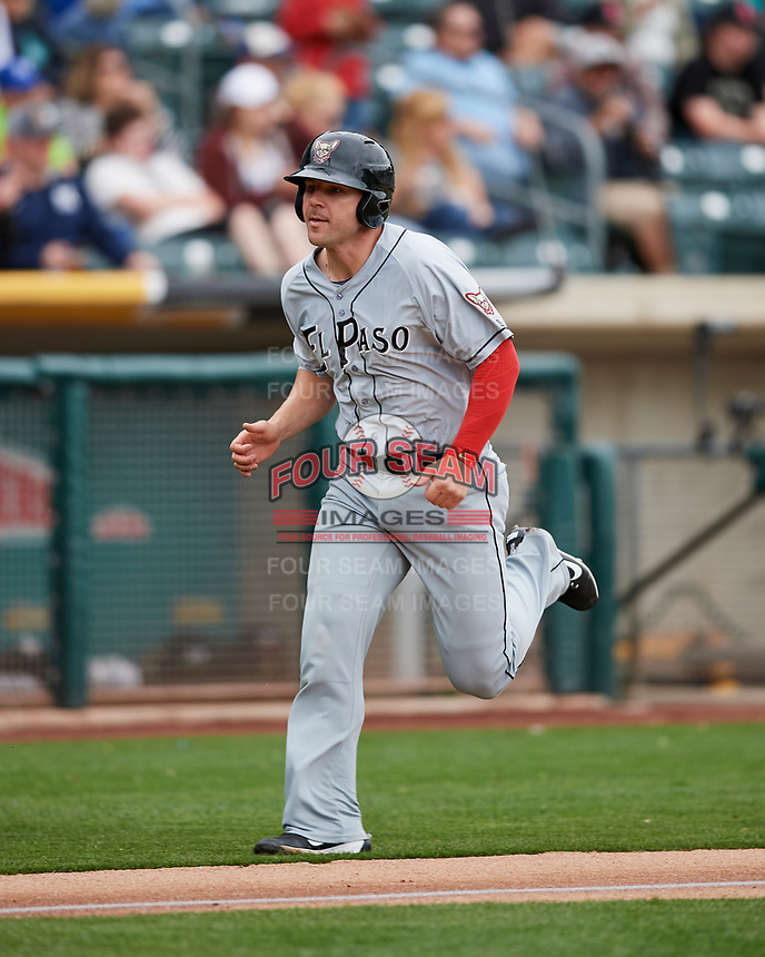 Jamie Romak (4) of the El Paso Chihuahuas scores against the Salt Lake Bees in Pacific Coast League action at Smith's Ballpark on April 30, 2017 in Salt Lake City, Utah.   El Paso defeated Salt Lake 12-3. This was Game 2 of a double-header originally scheduled on April 28, 2017.(Stephen Smith/Four Seam Images)