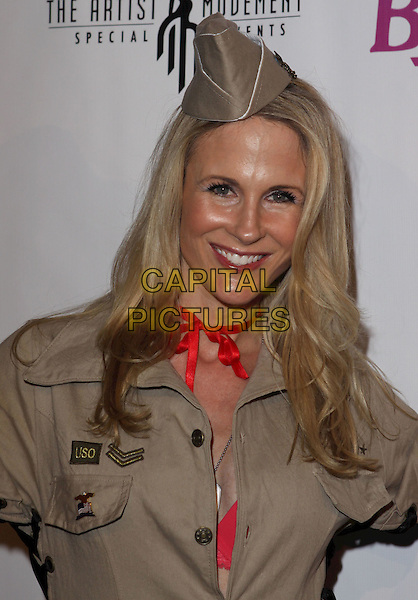 CHANEL RYAN.Benchwarmers Annual Halloween Party held at the Cabana Club, Hollywood, CA, USA..October 29th, 2010.headshot portrait boy scout hat beige red scarf.CAP/ADM/CH.©Charles Harris/AdMedia/Capital Pictures