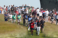 Tony Finau (USA) and Daniel Berger (USA) walk the first hole during the final round of the 118th U.S. Open Championship at Shinnecock Hills Golf Club in Southampton, NY, USA. 17th June 2018.<br /> Picture: Golffile | Brian Spurlock<br /> <br /> <br /> All photo usage must carry mandatory copyright credit (&copy; Golffile | Brian Spurlock)