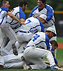 Division Avenue teammates celebrate after their 4-0 win over Bayport-Blue Point in the Class A varsity baseball Long Island Championship at New York Institute of Technology on Saturday, June 6, 2015.<br /> <br /> James Escher
