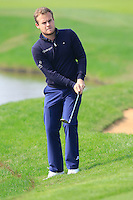 Tyrrell Hatton (ENG) chips onto the 9th green during Sunday's Final Round of the 2014 BMW Masters held at Lake Malaren, Shanghai, China. 2nd November 2014.<br /> Picture: Eoin Clarke www.golffile.ie