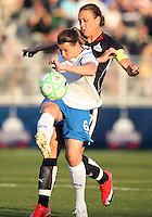 Abby Wambach #20 of the Washington Freedom loses the ball to Amy LePelbet #6 of the Boston Breakers during a WPS match at the Maryland Soccerplex, in Boyd's, Maryland, on April 18 2009.