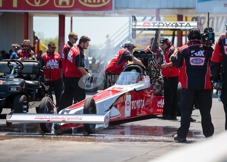 Apr 14, 2019; Baytown, TX, USA; Crew members for NHRA top fuel driver Doug Kalitta during the Springnationals at Houston Raceway Park. Mandatory Credit: Mark J. Rebilas-USA TODAY Sports