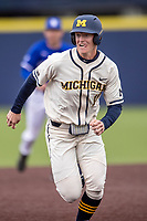 Michigan Wolverines first baseman Jimmy Kerr (15) runs to third base against the Indiana State Sycamores on April 10, 2019 in the NCAA baseball game at Ray Fisher Stadium in Ann Arbor, Michigan. Michigan defeated Indiana State 6-4. (Andrew Woolley/Four Seam Images)