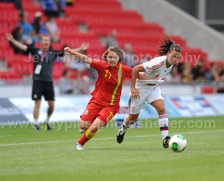 Ellen Rose Curson of Wales battles with Anna Fisker of Denmark during the UEFA Womens U19 Championships at Parc y Scarlets, Monday 19th August 2013. All images are the copyright of Jeff Thomas Photography-www.jaypics.photoshelter.com-07837 386244-Any use of images must be authorised by the copyright owner.