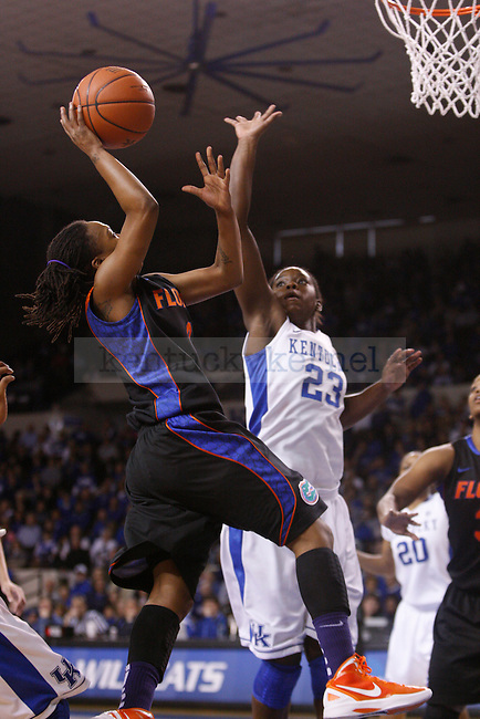 UK forward Samarie Walker attempts to block a shot during the first half of the UK Women's basketball game against Florida on 1/22/12 at Memorial Coliseum in Lexington, Ky. Photo by Quianna Lige | Staff