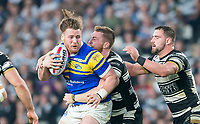 Picture by Allan McKenzie/SWpix.com - 19/04/2018 - Rugby League - Betfred Super League - Hull FC v Leeds Rhinos - KC Stadium, Kingston upon Hull, England - Leeds's Anthony Mullally is tackled by Hull FC's Scott Taylor.